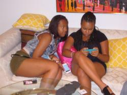 Shamauria watches as Kennedie checks her messages